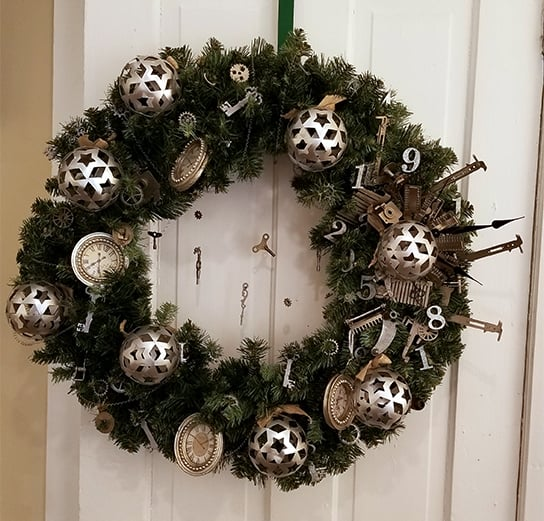 A steampunk-inspired wreath with gears, keys, and numbers, designed by Kara Edie